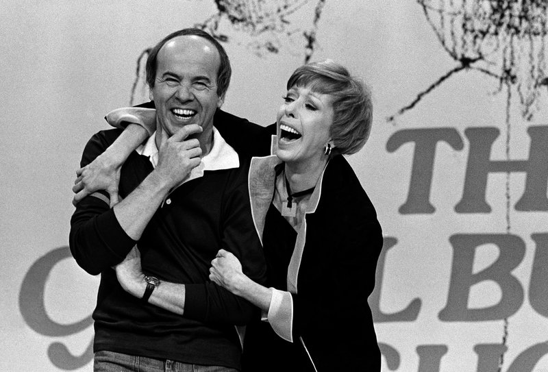 FILE - In this March 19, 1978 file photo, Carol Burnett, right, laughs with Tim Conway during taping of her final show, in Los Angeles. (AP Photo/ George Brich, File)