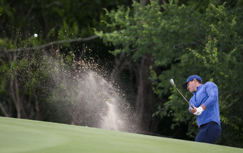 Brooks Koepka takes a shot from a bunker on the 15th hole during the second round of the Bryon Nelson golf tournament Friday, May 9, 2019, at Trinity Forest in Dallas. (Ashley Landis/The Dallas Morning News via AP)