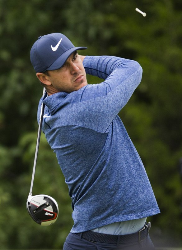 Brooks Koepka watches his tee shot on the 14th hole during the second round of the Bryon Nelson golf tournament Friday, May 9, 2019, at Trinity Forest in Dallas. (Ashley Landis/The Dallas Morning News via AP)