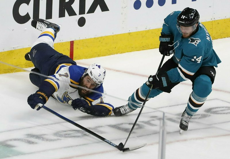 In this Monday, May 13, 2019 photo, Blues Pat Maroon tries to get to the puck but Sharks Gustav Nyquist is able to control it during the third period in Game 2 of the NHL hockey Stanley Cup Western Conference finals in San Jose, Calif. (J.B. Forbes/St. Louis Post-Dispatch via AP)