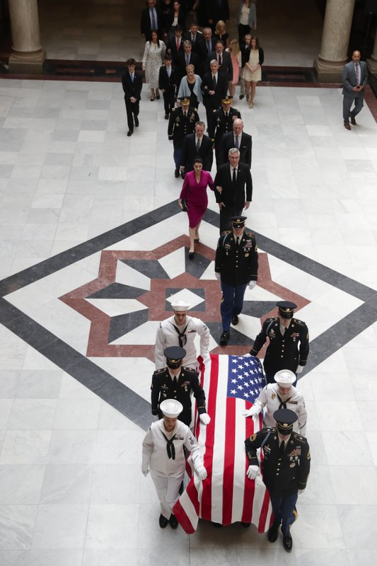A military honor guard escorts the casket of Sen. Richard Lugar into the Indiana Statehouse in Indianapolis, Tuesday, May 14, 2019. (AP Photo/Michael Conroy)