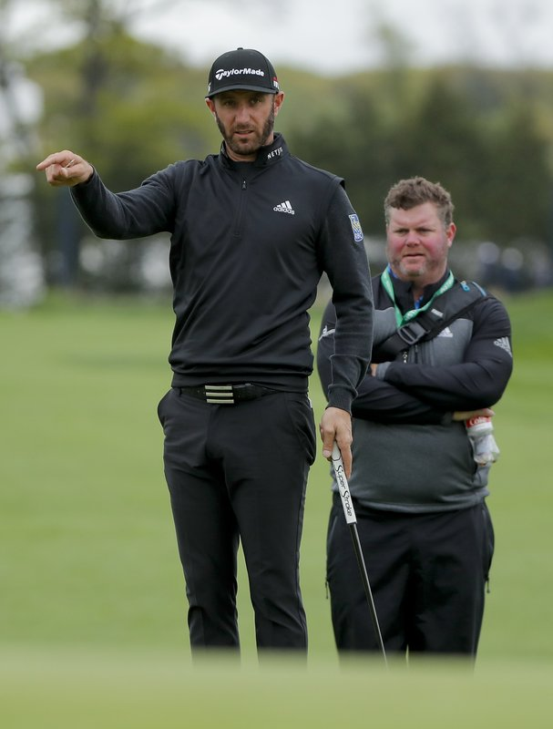 Dustin Johnson checks the break in the green on the 11th hole during a practice round at the PGA Championship golf tournament, Tuesday, May 14, 2019, in Farmingdale, N. (AP Photo/Julie Jacobson)