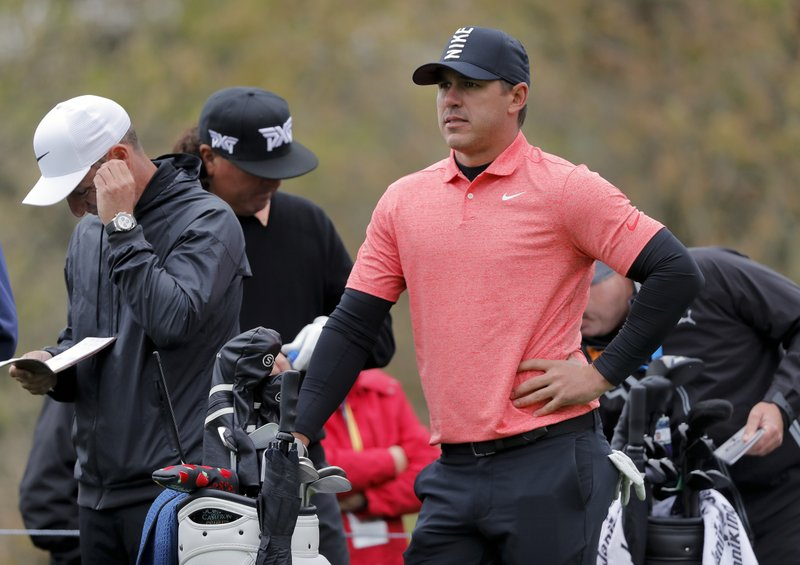 Brooks Koepka waits to tee off on the second hole a practice round at the PGA Championship golf tournament, Tuesday, May 14, 2019, in Farmingdale, N. (AP Photo/Julie Jacobson)
