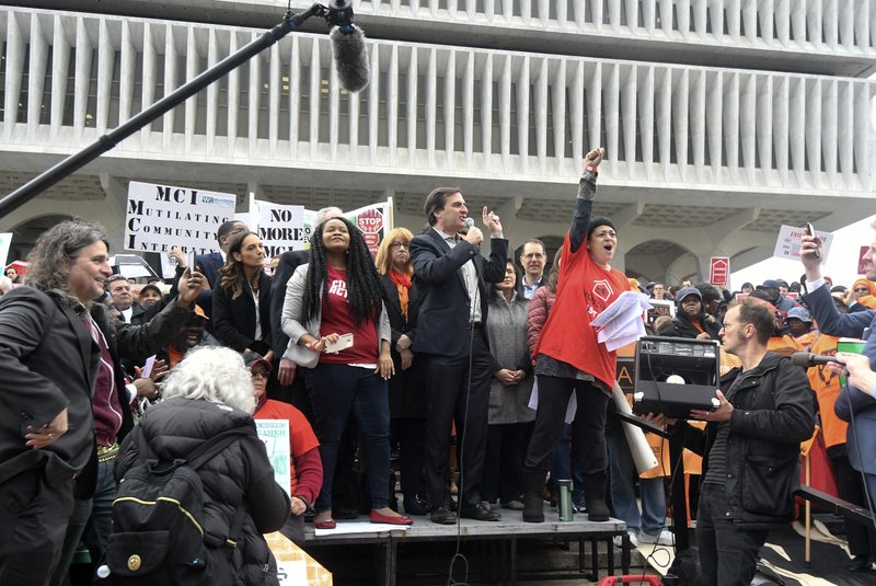 New York State Senate Deputy Leader Michael Gianaris, center, stands with tenants and elected officials during a rally at the state Capitol Tuesday, May 14, 2019, in Albany, N. (AP Photo/Hans Pennink)