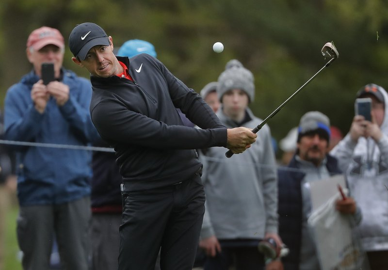 Rory McIlroy chips onto the seventh green during a practice round for the PGA Championship golf tournament, Tuesday, May 14, 2019, in Farmingdale, N. (AP Photo/Julie Jacobson)