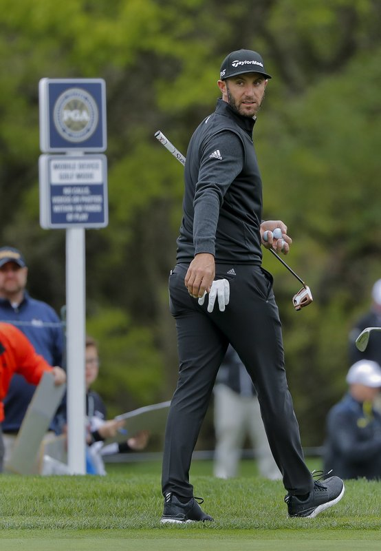 Dustin Johnson walks off the seventh green during a practice round at the PGA Championship golf tournament, Tuesday, May 14, 2019, in Farmingdale, N. (AP Photo/Julie Jacobson)