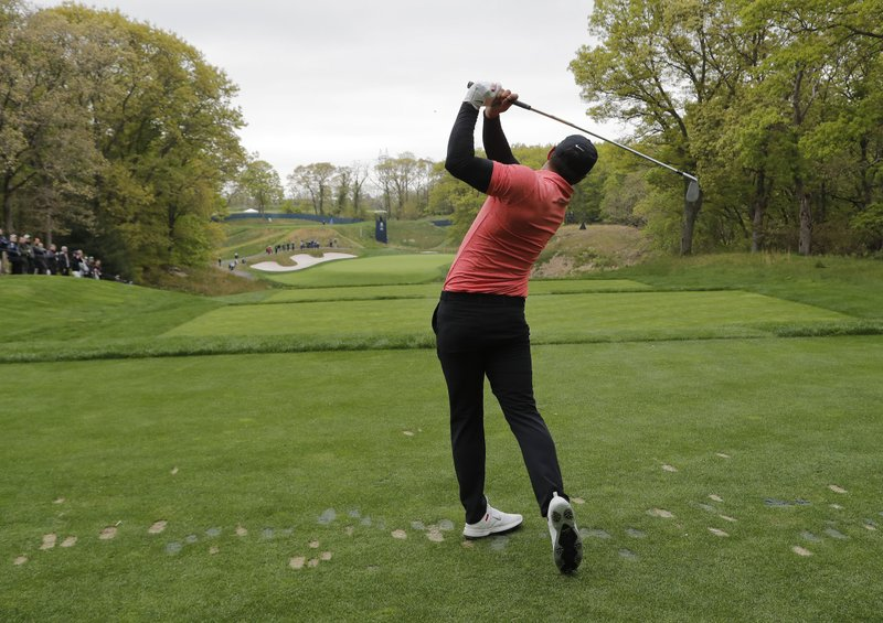 Brooks Koepka tees off the eighth hold during a practice round for the PGA Championship golf tournament, Tuesday, May 14, 2019, at Bethpage Black in Farmingdale, N. (AP Photo/Julie Jacobson)