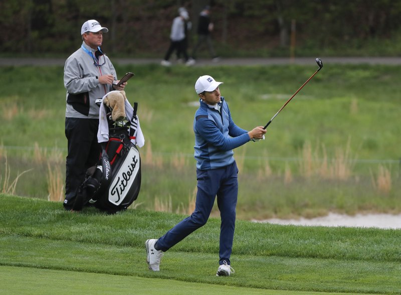 Jordan Spieth follows through on an approach shot on the fourth fairway during a practice round for the PGA Championship golf tournament, Tuesday, May 14, 2019, in Farmingdale, N. (AP Photo/Julie Jacobson)