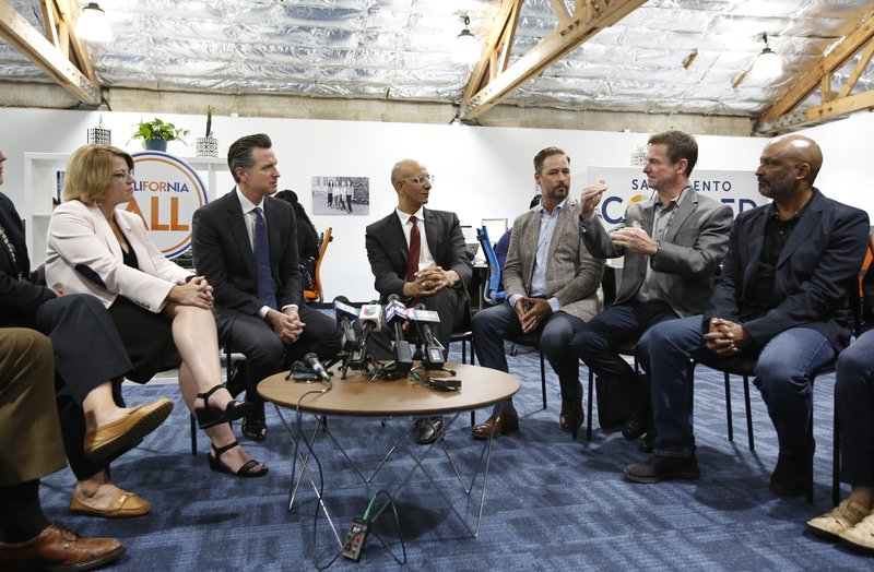 Jim Holifield, who is semi-retired and runs his own part time consulting firm, describes the problems of getting health insurance to California  Gov. (AP Photo/Rich Pedroncelli)