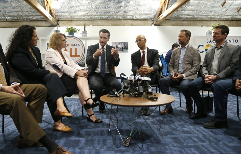 California Gov. Gavin Newsom, third from left, discusses his health care proposals at a round table discussion with small business owners Tuesday, May 14, 2019, in Sacramento, Calif. (AP Photo/Rich Pedroncelli)