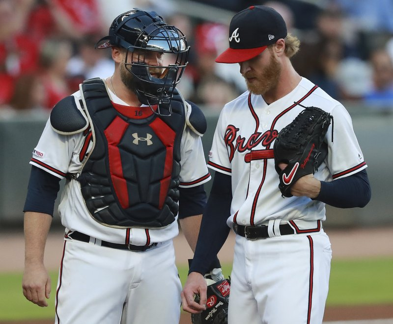 Atlanta Braves catcher Brian McCann confers with pitcher Mike Foltynewicz, who had given up a three-run home run to St. (Curtis Compton/Atlanta Journal-Constitution via AP)