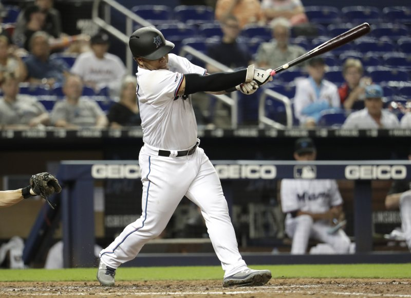 Miami Marlins' Harold Ramirez hits single in the eighth inning during a baseball game against the Tampa Bay Rays, Tuesday, May 14, 2019, in Miami. (AP Photo/Lynne Sladky)