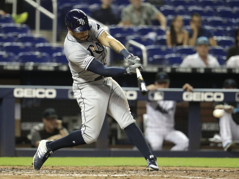 Tampa Bay Rays' Tommy Pham hits a single in the ninth inning during a baseball game against the Miami Marlins, Tuesday, May 14, 2019, in Miami. (AP Photo/Lynne Sladky)