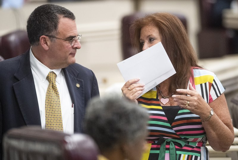 Rep. Terri Collins, right, chats with Rep. Chris Pringle on the house floor at the Alabama Statehouse in Montgomery, Ala. (Mickey Welsh/Montgomery Advertiser via AP)