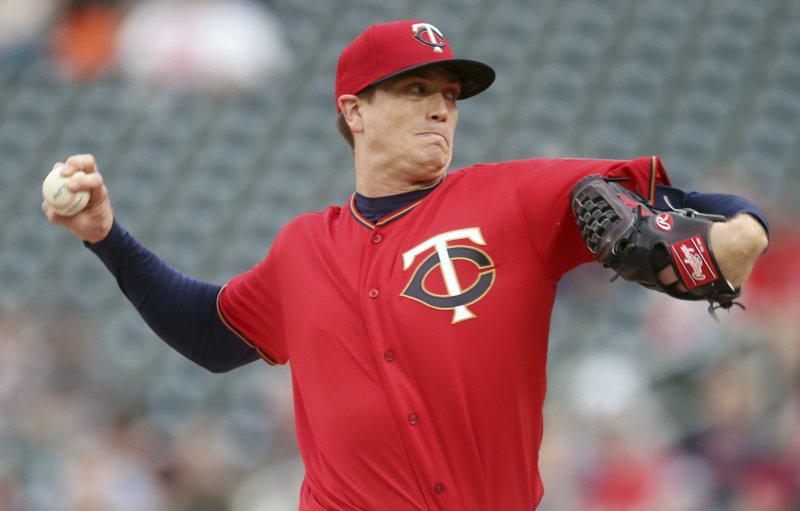 Minnesota Twins pitcher Kyle Gibson throws against the Los Angeles Angels in the first inning of a baseball game Tuesday, May 14, 2019, in Minneapolis. (AP Photo/Jim Mone)