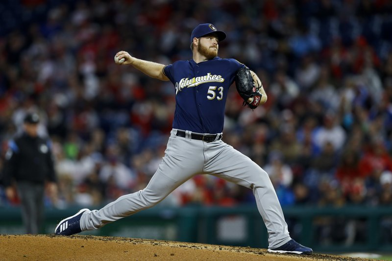 Milwaukee Brewers' Brandon Woodruff pitches during the third inning of a baseball game against the Philadelphia Phillies, Tuesday, May 14, 2019, in Philadelphia. (AP Photo/Matt Slocum)