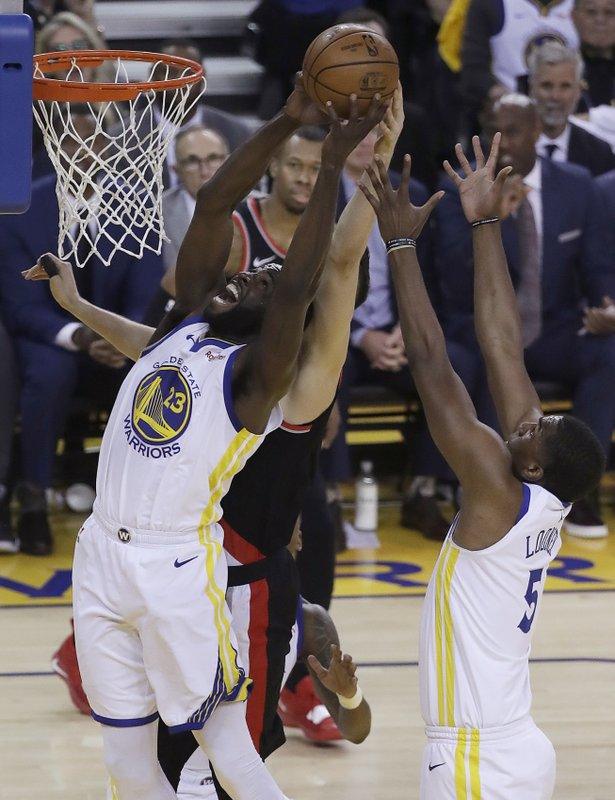 Golden State Warriors forward Draymond Green (23) grabs a rebound against the Portland Trail Blazers during the first half of Game 1 of the NBA basketball playoffs Western Conference finals in Oakland, Calif. (AP Photo/Jeff Chiu)