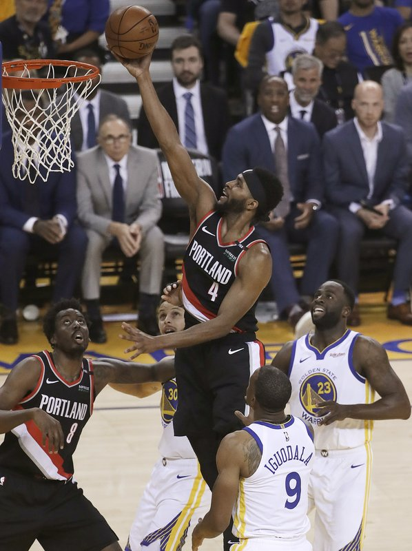 Portland Trail Blazers forward Maurice Harkless (4) shoots against the Golden State Warriors during the first half of Game 1 of the NBA basketball playoffs Western Conference finals in Oakland, Calif. (AP Photo/Jeff Chiu)