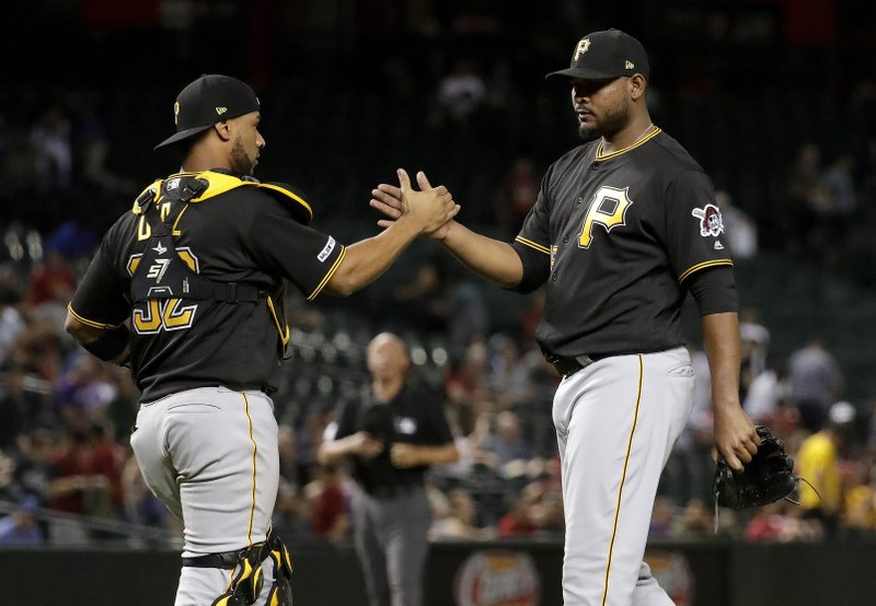 Pittsburgh Pirates relief pitcher Michael Feliz celebrates with catcher Elias Diaz after the team's baseball game against the Arizona Diamondbacks, Tuesday, May 14, 2019, in Phoenix. (AP Photo/Matt York)