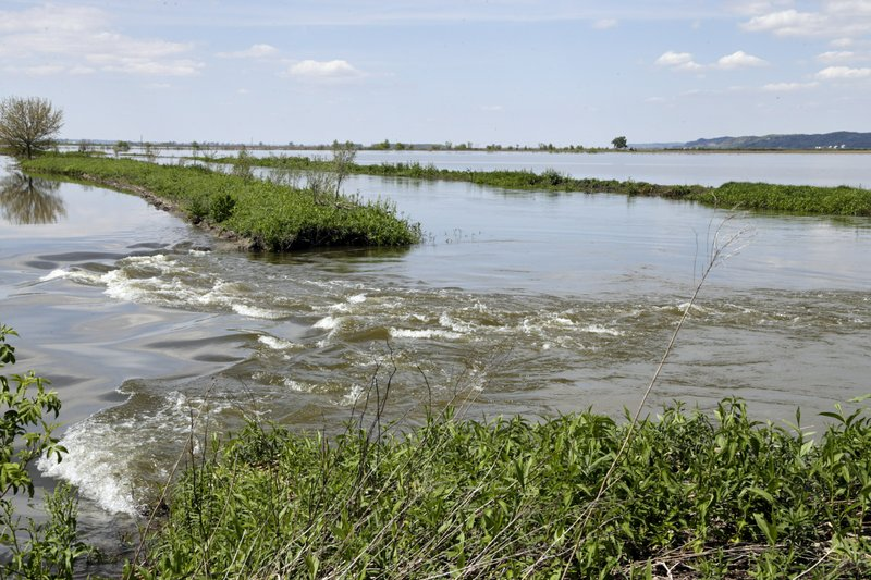 In this May 10, 2019 photo, flood waters from the Missouri River flow through a break in a levee, north of Hamburg, Iowa. (AP Photo/Nati Harnik)
