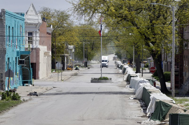 In this May 10, 2019 photo, barriers constructed to hold back flood waters from the Missouri River, line a street in Hamburg, Iowa. (AP Photo/Nati Harnik)