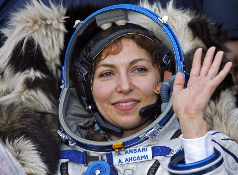 FILE - In this Sept. 29, 2006 file photo, U.S. space tourist Anousheh Ansari waves shortly after landing near the town of Arkalyk, northern Kazakhstan. (AP Photo/Misha Japaridze, File)