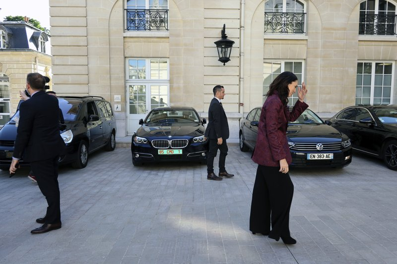 New Zealand Prime Minister Jacinda Ardern, right, leaves after a press conference, at the OECD headquarters, in Paris, Tuesday, May 14, 2019. (AP Photo/Thibault Camus)
