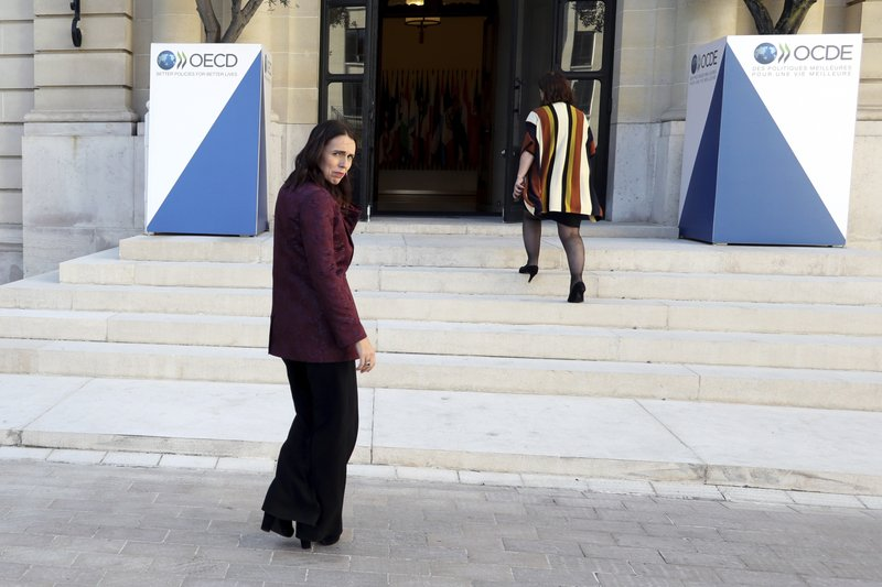 New Zealand Prime Minister Jacinda Ardern, left, leaves after a press conference, at the OECD headquarters, in Paris, Tuesday, May 14, 2019. (AP Photo/Thibault Camus)