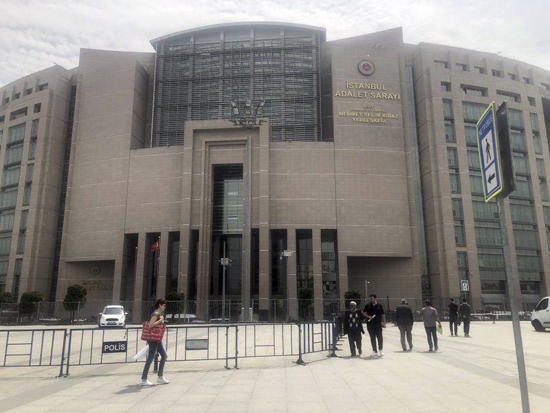 People walk to the main Justice Palace in Istanbul, Wednesday, May 15, 2019, as the trial begins against Metin Topuz, a Turkish employee of the United States Consulate in Istanbul charged with espionage and attempting to overthrow the Turkish government. (AP Photo/Mehmet Guzel)