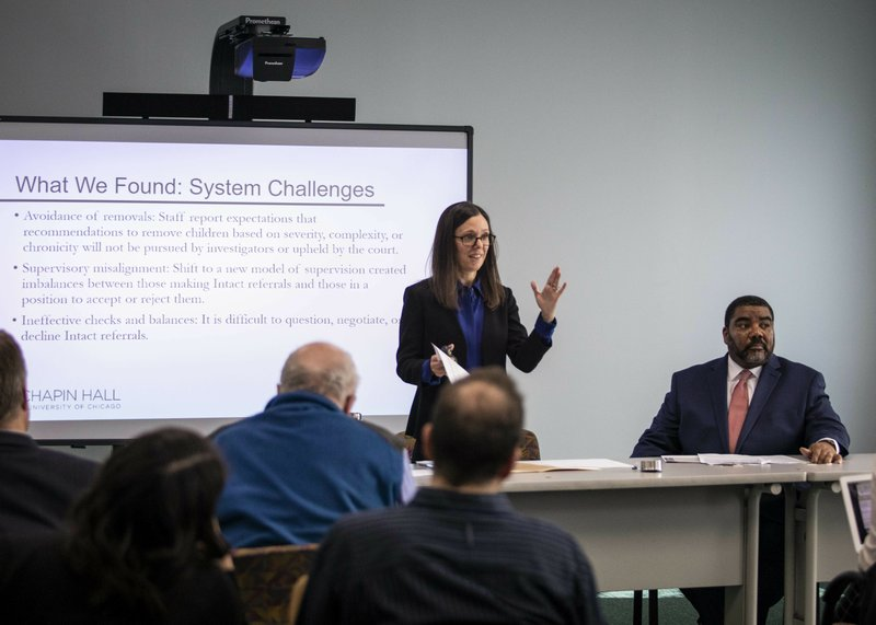In this May 13, 2019 photo, Dana Weiner, left, policy fellow at Chapin Hall at the University of Chicago, and Illinois Department of Children and Family Services Acting Director Marc Smith discuss a review of the DCFS Intact Family Services program, during a press event in Chicago. A study released Wednesday, May 15, 2019, has found that Illinois' child welfare agency is so intent on keeping children with their parents and not putting them in foster care despite strong indications that they've been physically abused or neglected that it has put those children in greater danger. (Ashlee Rezin/Sun Times via AP)/Chicago Sun-Times via AP)