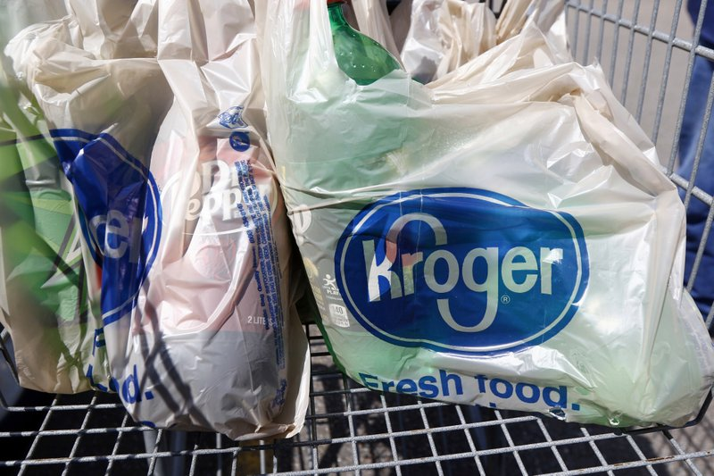 FILE - In this June 15, 2017, file photo, bagged purchases from the Kroger grocery store in Flowood, Miss. (AP Photo/Rogelio V. Solis, File)