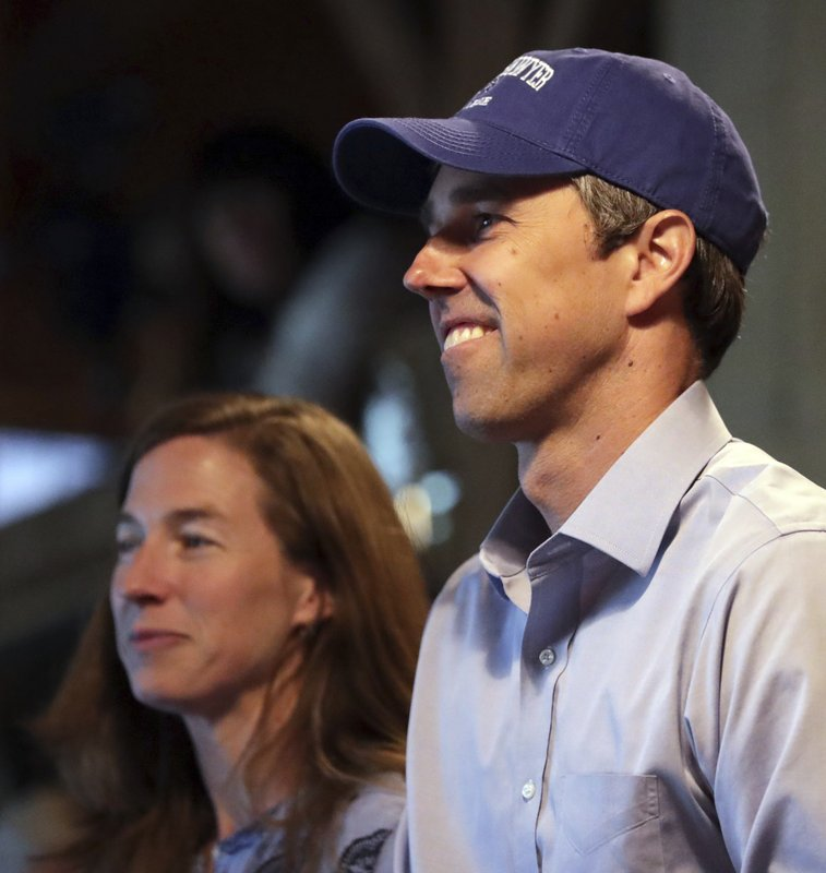 Democratic presidential candidate and former Texas Congressman Beto O'Rourke smiles as he stands with his wife Amy while being introduced at Colby-Sawyer College in New London, N. (AP Photo/Charles Krupa)