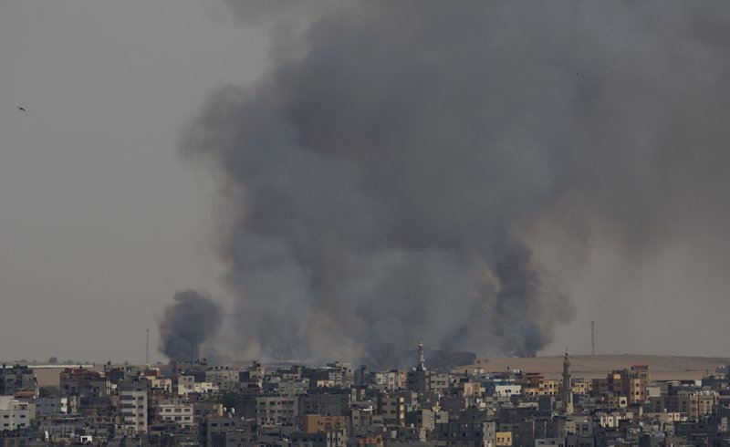 Smoke rises from fires on Israeli farmland caused by arson balloons launched from Gaza City, Wednesday, May 15, 2019. (AP Photo/Hatem Moussa)