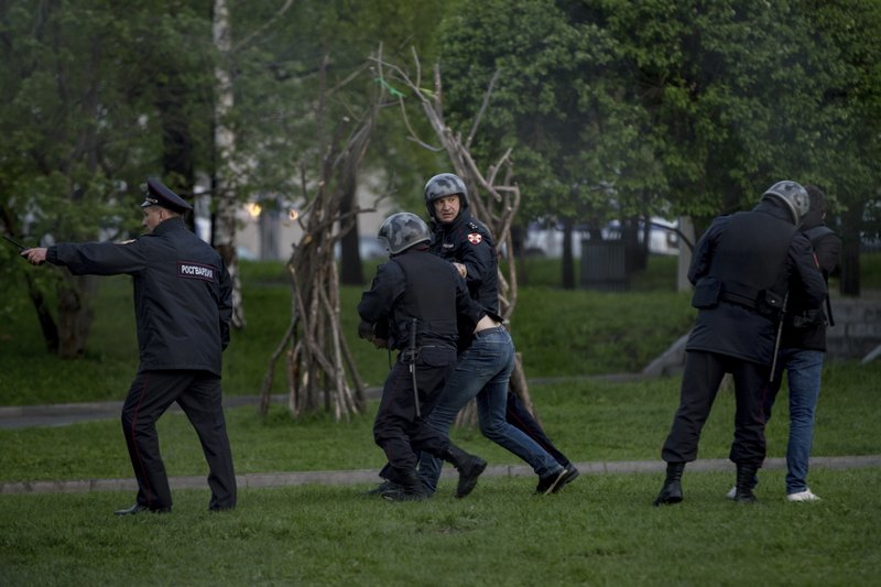 Police officers detain demonstrators who protest plans to construct a cathedral in a park in Yekaterinburg, Russia, Tuesday, May 14, 2019. (AP Photo/Anton Basanayev)