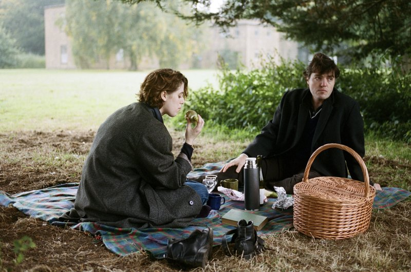 This image released by A24 shows Tom Burke, right, and Honor Swinton Byrne in a scene from