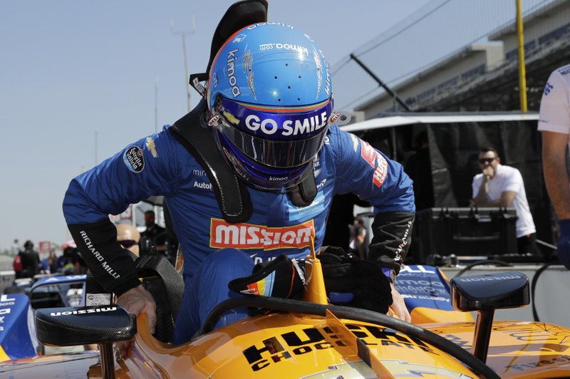 Fernando Alonso, of Spain, climbs into his car to practice for the Indianapolis 500 IndyCar auto race at Indianapolis Motor Speedway, Tuesday, May 14, 2019, in Indianapolis. (AP Photo/Darron Cummings)