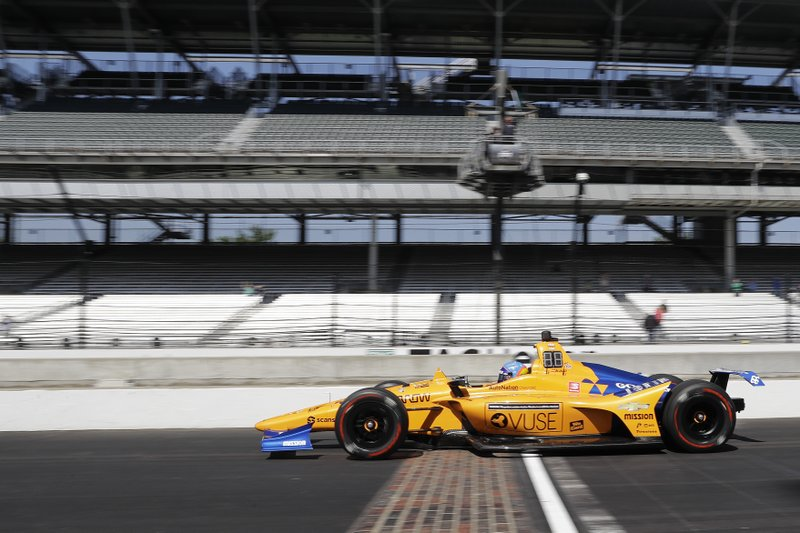 Fernando Alonso, of Spain, leaves the pits during practice for the Indianapolis 500 IndyCar auto race at Indianapolis Motor Speedway, Tuesday, May 14, 2019, in Indianapolis. (AP Photo/Darron Cummings)