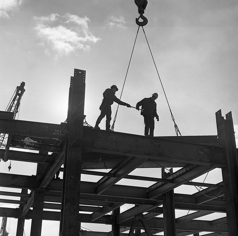 In this undated photo provided by the National Museum of Industrial History, construction workers help guide a girder into place during the construction of Martin Tower in Bethlehem, Pa. (National Museum of Industrial History via AP)