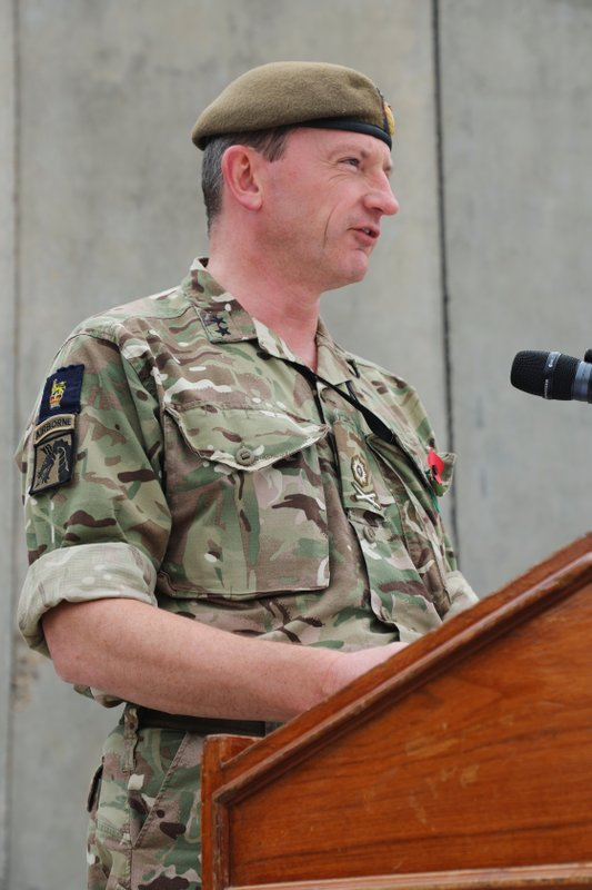In this Nov. 11, 2018, photo, British army Maj. Gen. Christopher Ghika, deputy commander for Strategy and Information Combined Joint Task Force - Operation Inherent Resolve (CJTF-OIR), speaks before a gathering of coalition forces at the Armistice Ceremony at Union III, Baghdad. (Sgt. Phillip McTaggart/U.S. Army via AP)