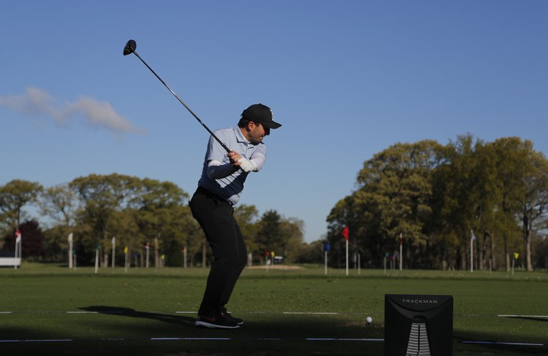 Francesco Molinari, of Italy, hits on the driving range before a practice round for the PGA Championship golf tournament, Wednesday, May 15, 2019, at Bethpage Black in Farmingdale, N. (AP Photo/Julie Jacobson)