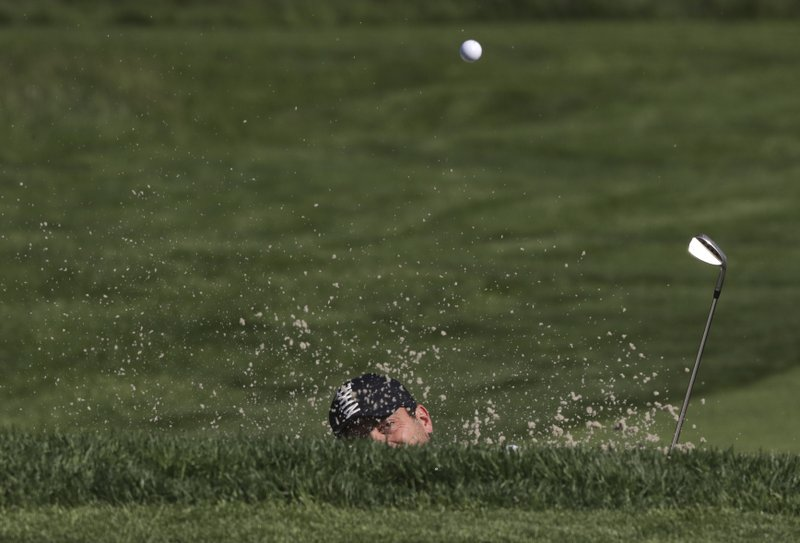Francesco Molinari, of Italy, hits out of a bunker on the 11th hole during a practice round for the PGA Championship golf tournament, Wednesday, May 15, 2019, at Bethpage Black in Farmingdale, N. (AP Photo/Charles Krupa)