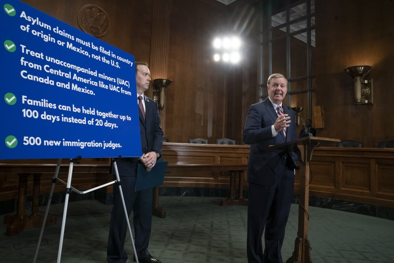Senate Judiciary Committee Chairman Lindsey Graham, R-S.C., an ally of President Donald Trump, is joined by Acting U. (AP Photo/J. Scott Applewhite)