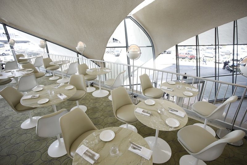 Tables are set for visitors in the Paris Cafe during the opening of the TWA Hotel at New York's John F. (AP Photo/Mark Lennihan)