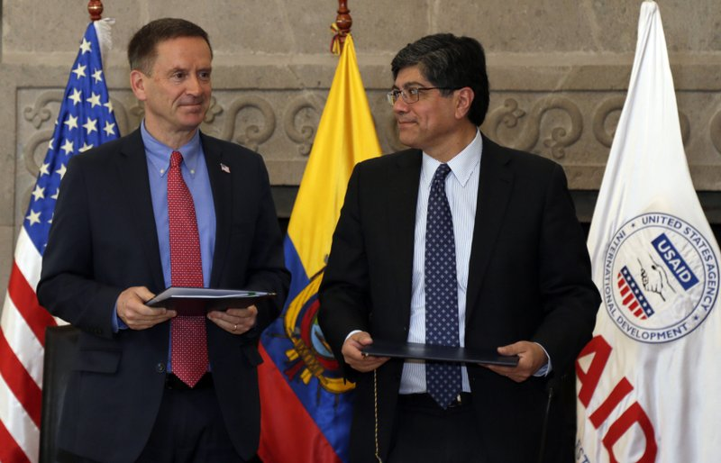 Mark Green, USAID Administrator, and Ecuador's Foreign Minister Jose Valencia, stand during a signing ceremony in Quito, Ecuador, Wednesday, May 15, 2019. (AP Photo/Dolores Ochoa)