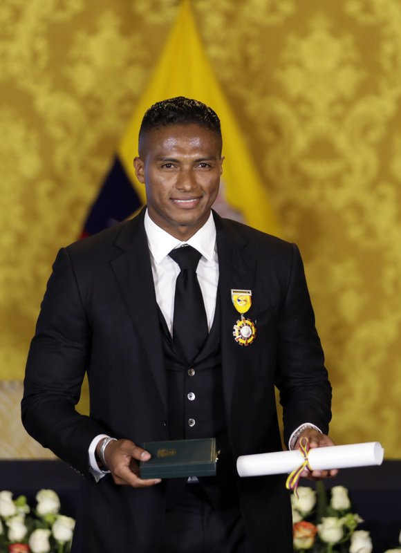 Soccer star Antonio Valencia poses for a photo after a ceremony in which the fullback was decorated with a National Order of Merit, in Quito, Ecuador, Tuesday, May 14, 2019. (AP Photo/Dolores Ochoa)