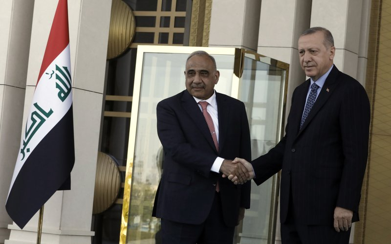 Turkish President Recep Tayyip Erdogan, right, and Iraqi Prime Minister Adel Abdul-Mahdi shake hands during a welcome ceremony, in Ankara, Turkey, Wednesday, May 15, 2019.(AP Photo/Burhan Ozbilici)