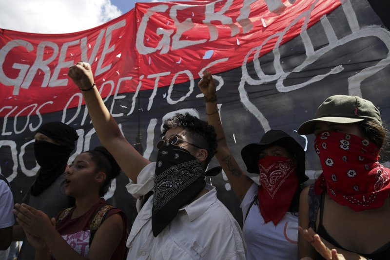 Students take part in a nation-wide education strike, in Brasilia, Brazil, Wednesday, May 15, 2019. Federal education officials this month announced budget cuts of $1. (AP Photo/Eraldo Peres)