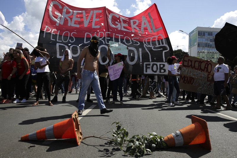 Demonstrators set up a barricade during nation-wide education strike, in Brasilia, Brazil, Wednesday, May 15, 2019. (AP Photo/Eraldo Peres)