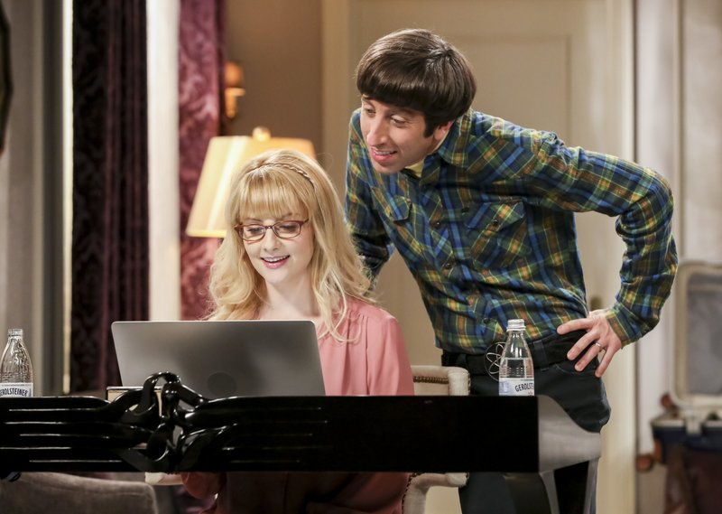This image released by CBS shows Melissa Rauch, left, and Simon Helberg in a scene from the series finale of