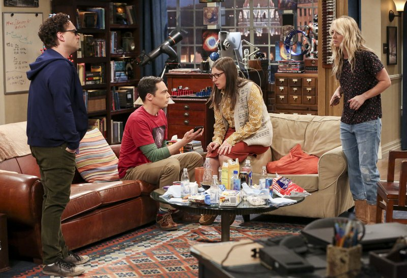 This image released by CBS shows, from left, Johnny Galecki, Jim Parsons, Mayim Bialik and Kaley Cuoco in a scene from the series finale of
